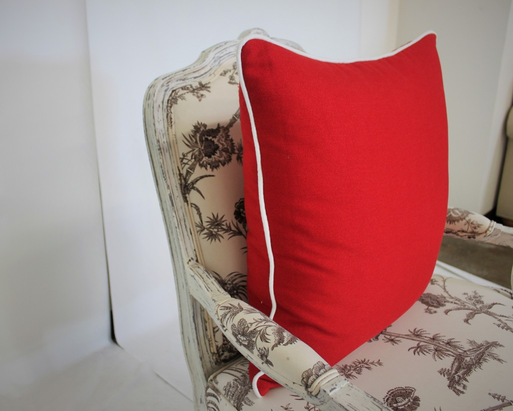 Red Pillow with White Piping