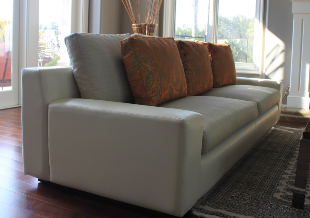 Custom sofa in vinyl body and linen cushions